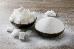 FILE PHOTO: Granulated white sugar and sugar cubes are seen in this picture illustration taken December 16, 2018. REUTERS/Emmanuel Foudrot/Illustration/File Photo